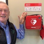 EKCs Don Holt with defibrillator in Cranbrook branch